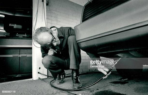 State Test Center Emissions Dick Robinson Foreman places a probe into the exhaust pipe of a car Credit The Denver Post