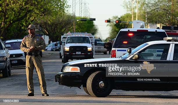 A state trooper mans a roadblock in West Texas on April 18 2013 a day after a deadly fertilizer plant blast Rescuers in Texas combed through rubble...