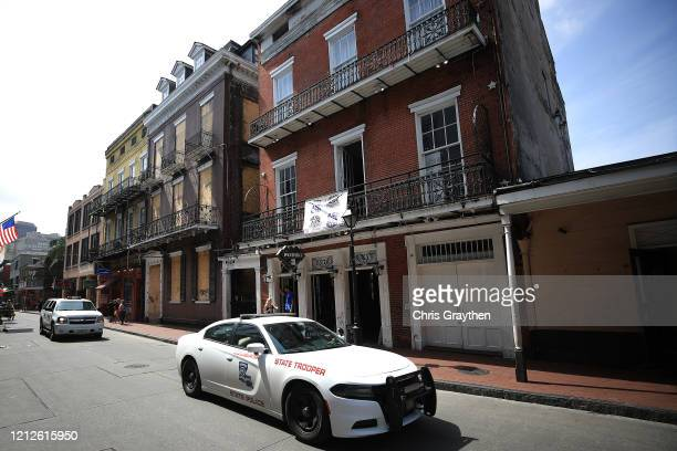 State Trooper vehicle drives down Bourbon Street in the French Quarter on March 15, 2020 in New Orleans, Louisiana. The state government has placed a...