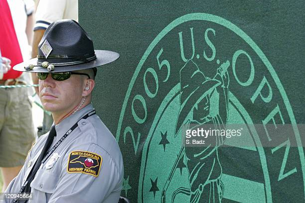A State Trooper works security during practice for the 2005 US Open Golf Championship at Pinehurst Resort course 2 in Pinehurst North Carolina on...