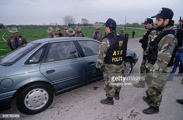 State troopers and members of the Bureau of Alcohol Tobacco and Firearms stop a motorist during the 1993 Branch Davidian standoff near Waco Texas A...