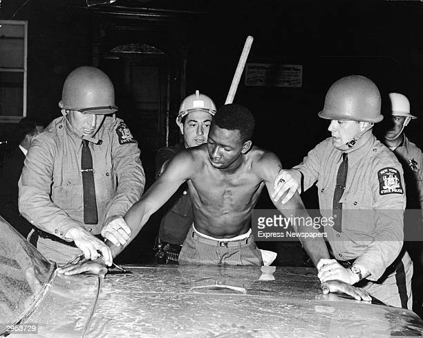 State Troopers arrest a man for breaking a curfew during the race riot of 24th-26th July 1964 in Rochester, New York.