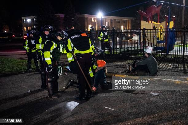 State troopers arrest demonstrators during the sixth night of protests over the shooting death of Daunte Wright by a police officer in Brooklyn...