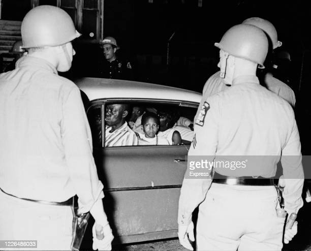 State troopers check vehicles in the Rochester area of New York State following the Rochester race riot 29th July 1964