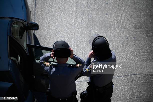 State troopers gear up at an exit of the Vine Express way as protestors clash with police near City Hall in Philadelphia PA on May 30 2020 Cities...