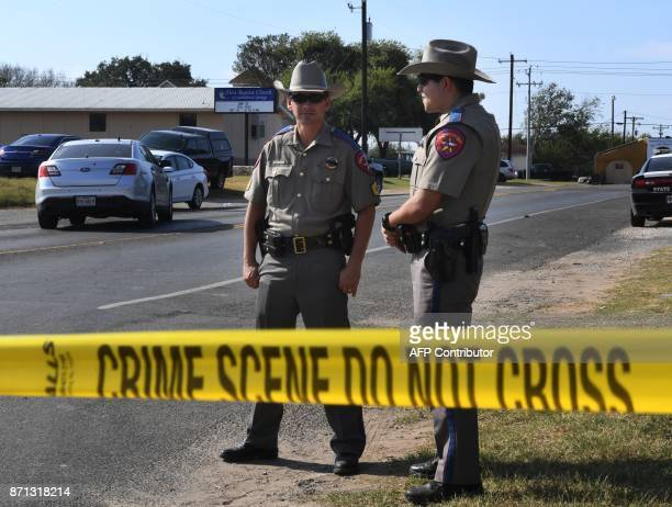 State troopers stand guard outside the First Baptist Church after a mass shooting that killed 26 people in Sutherland Springs Texas on November 7...
