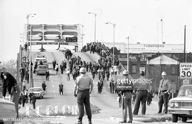 State troopers watch as marchers cross the Edmund Pettus Bridge over the Alabama River in Selma, Alabama as part of a civil rights march on March 9....