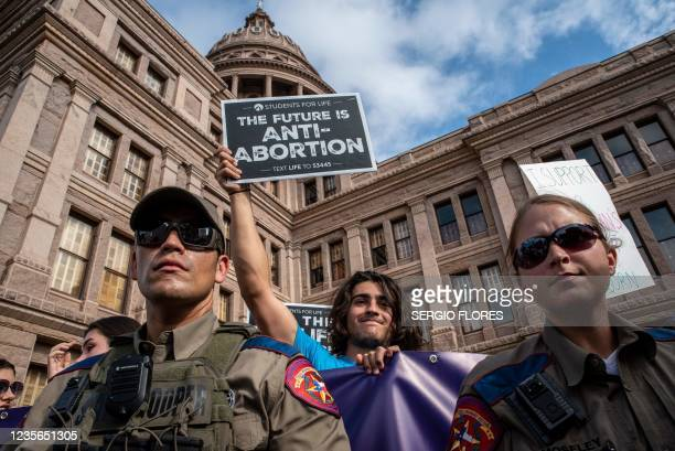 State troopers watch as protesters take part in the Women's March and Rally for Abortion Justice at the State Capitol in Austin, Texas, on October 2,...