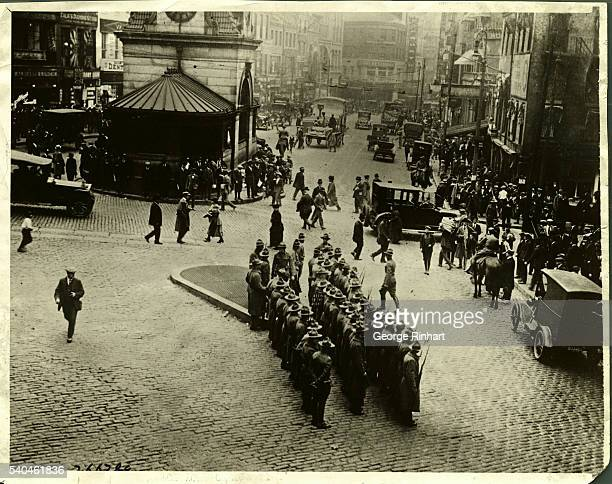 State troops are shown in this photograph on guard in Schollay Square where serious rioting and great damage was done Seven were killed and hundreds...