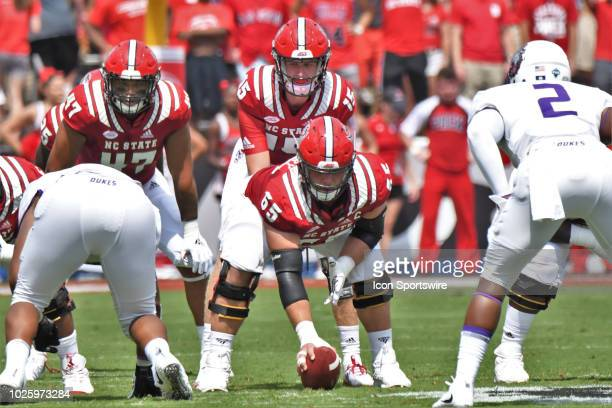 State Wolfpack C Garrett Bradbury centers the ball in front of QB Ryan Finley during the game between the James Madison Dukes and the NC State...