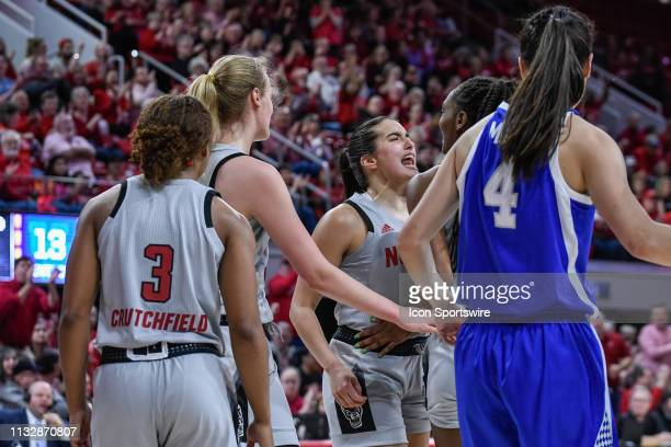 State Wolfpack forward DD Rogers and NC State Wolfpack guard Aislinn Konig celebrate the basket during the 2019 Div 1 Championship Second Round...