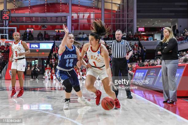 State Wolfpack guard Aislinn Konig cuts to the basket as Maine Black Bears guard Parise Rossignol defends during the 2019 Div 1 Women's Championship...