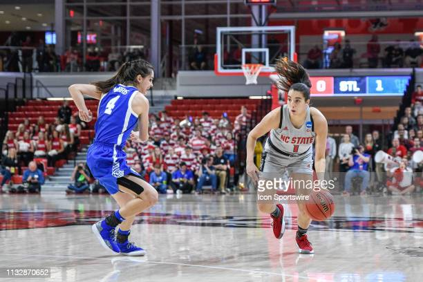 State Wolfpack guard Aislinn Konig is defended by Kentucky Wildcats guard Maci Morris during the 2019 Div 1 Championship Second Round college...