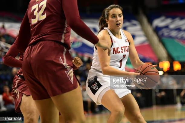State Wolfpack guard Aislinn Konig looks to pass during the ACC Women's basketball tournament between the NC State Wolfpack and the Florida State...