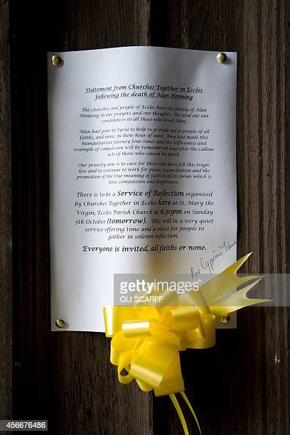 A statement from 'Churches Together in Eccles' paying tribute to murdered aid worker Alan Henning is attached to the entrance Eccles Parish Church in...