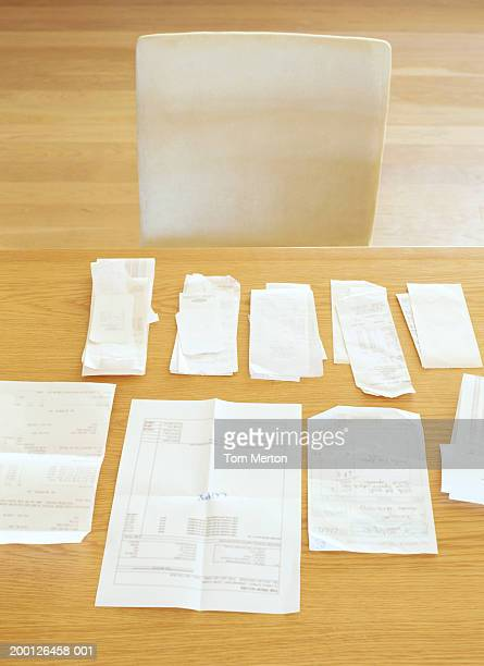 Statements and receipts on table, elevated view