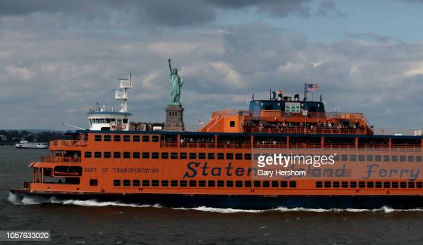 Staten Island Ferry passes the Statue of Liberty and Liberty Island on October 20, 2018 in New York City.