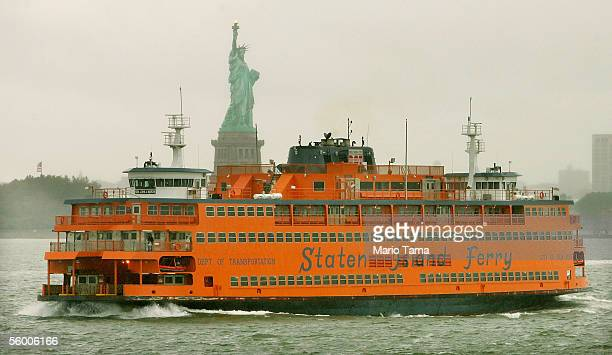 Staten Island ferry passes the Statue of Liberty on its 100th anniversary October 25, 2005 in New York City. In 1905, the ferries were powered by...