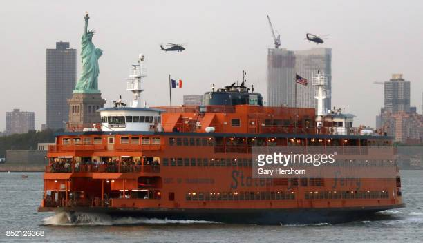 Staten Island Ferry sails past the Statue of Liberty in New York City on September 21, 2017.