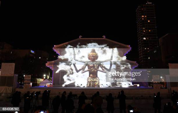 Stateoftheart projection mapping technology adds a whole new dimension to a snow sculpture of the Chukondo hall at Kofukuji temple during a preview a...
