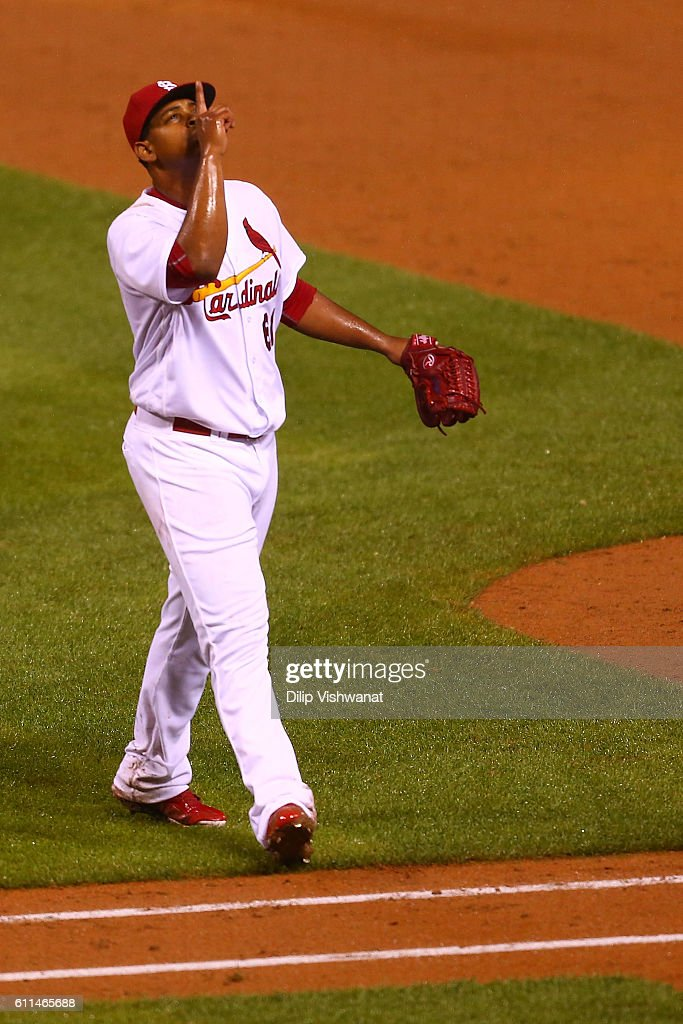 Stater Alex Reyes #61 of the St. Louis Cardinals celebrates after recording the third out with the bases loaded against the Cincinnati Reds in the sixth inning at Busch Stadium on September 29, 2016 in St. Louis, Missouri.