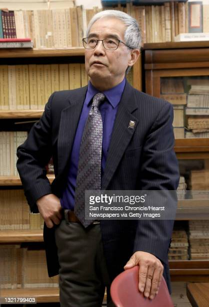State's Associate VP for International Education Dr. Yenbo Wu stands in the Chinese Reading Room in the humanities building at San Francisco State...