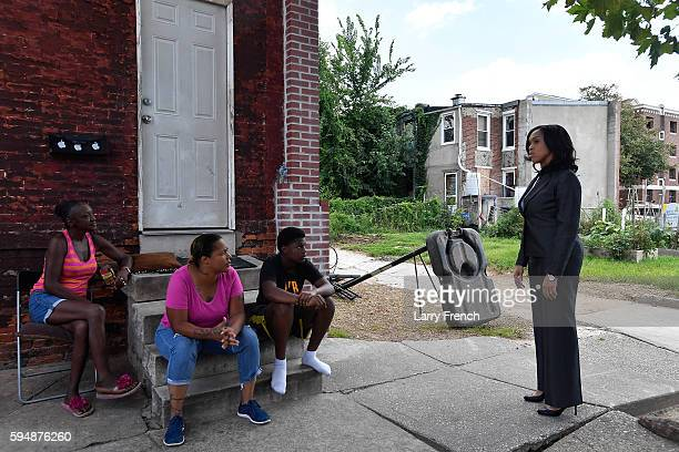 State's Attorney for Baltimore Maryland Marilyn J Mosby walks through the SandtownWinchester neighborhood where Freddie Gray was arrested on August...