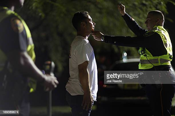 City of North Miami Beach police officer Ray DeJesus jr conducts a field sobriety test on a driver during a DUI checkpoint on May 23 2013 in Miami...