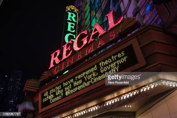 """States have reopened theaters safely, why not New York, Governor Cuomo"""" sign is displayed on the marquee at Regal Cinemas in Times Square on October..."""