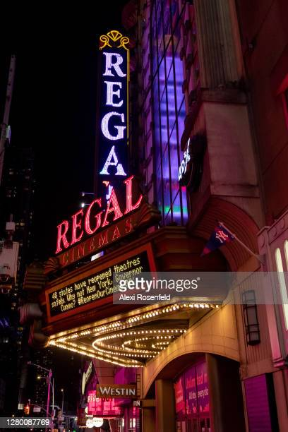 """States have reopened theaters safely, why not New York Governor Cuomo"""" sign is displayed on the marquee at Regal Cinemas in Times Square on October..."""