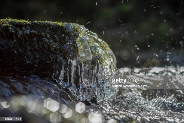 states of matter - wasserfall stock-fotos und bilder