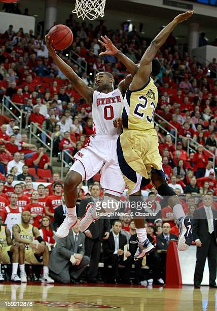 NC State's Rodney Purvis is fouled by Georgia Tech's Brandon Reed during the first half of the Wolfpack's game against the Yellow Jackets at PNC...