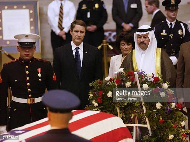 STATESenate Majority Leader Bill Frist RTenn and Iraq's new President Ghanzi al Yawar pay respects to former President Ronald Reagan in the Rotunda...