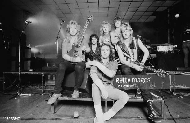Statetrooper British heavy metal band pose for a group portrait in October 1985 Two of the band members hold guitars as the band pose on a stage...