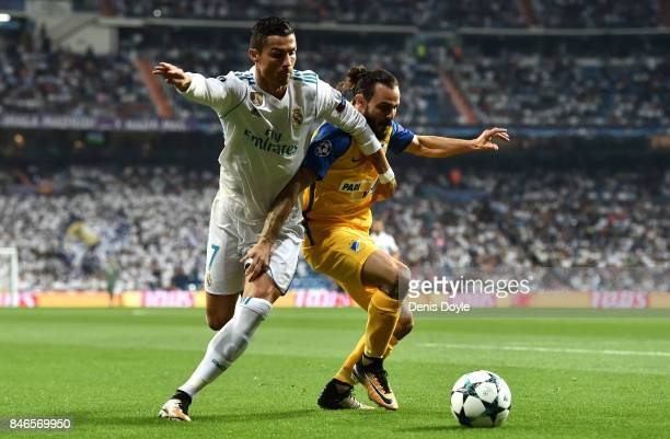 Stathis Aloneftis of Apoel battles with Cristiano Ronaldo of Real Madrid during the UEFA Champions League group H match between Real Madrid and APOEL...
