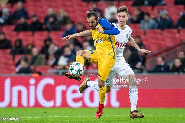 Stathis Aloneftis of APOEL Nicosia andJuan Foyth of Tottenham Hotspur fight for the ball during the UEFA Champions League group H match between...