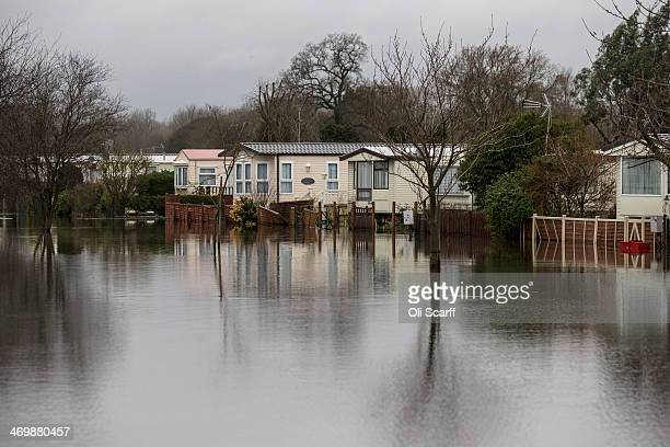 A static caravan park which is situated adjacent to the river Thames is surrounded by flood water on February 17 2014 in Hurley England The...