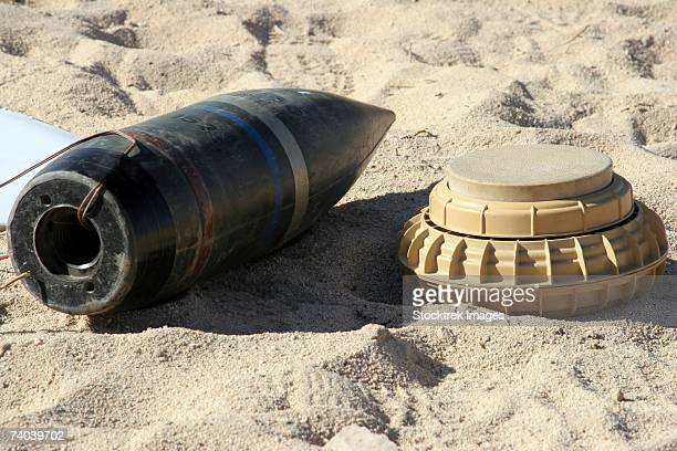 a static display of a converted ordnance shell and a simple mine are used at teaching tools for marines at the camp wilson ied lane. - land mine stock pictures, royalty-free photos & images
