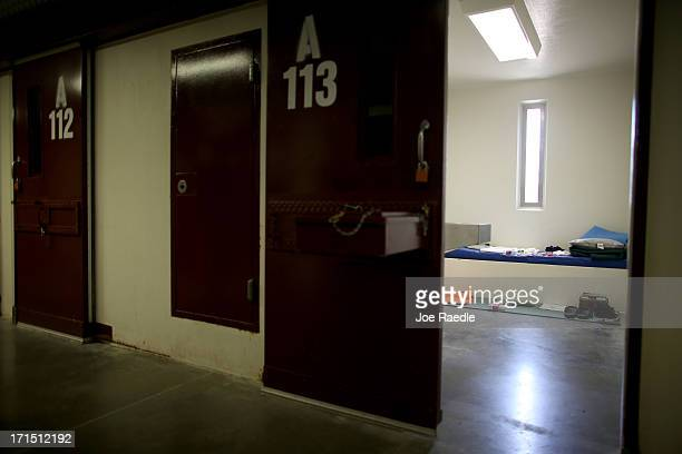A static display shows the belongings of a typical inmate in a prison cell at camp V where prisoners are housed in the single cell facility at the US...