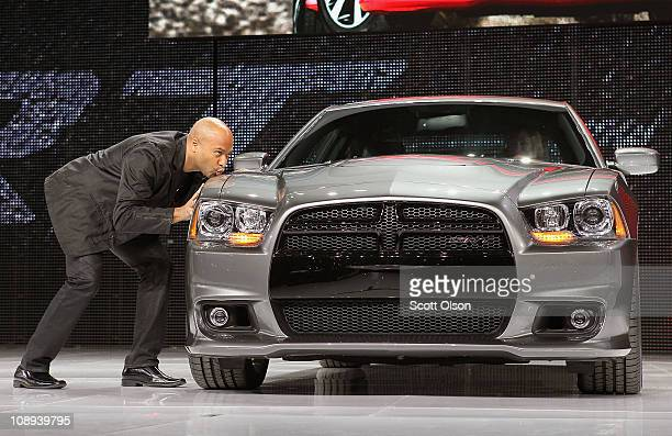 Stating he loves the car and can't wait for his own President and CEO of Dodge Brand Ralph Gilles kisses the fender of Dodge's new 2012 Charger SRT8...