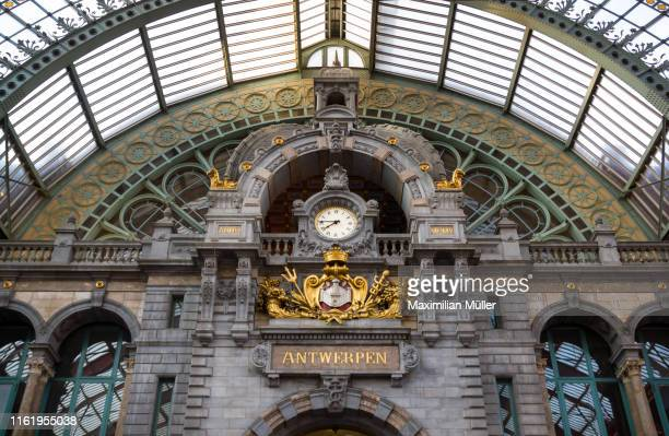 station clock, antwerpen-centraal railway station, antwerp, belgium - antwerp city belgium stock pictures, royalty-free photos & images