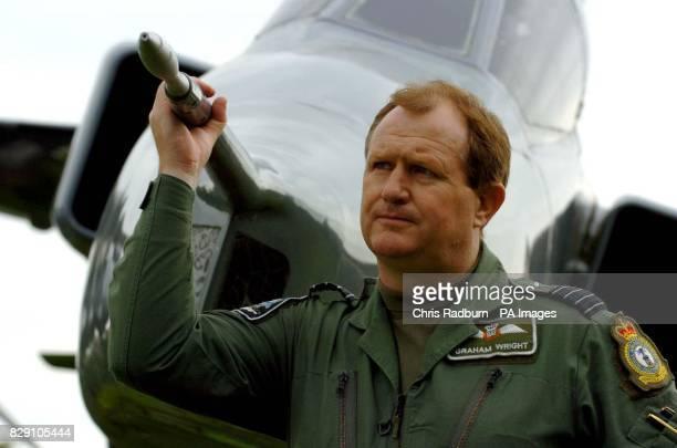 Station Commander Graham Wright stands alongsige a Jaguar fighter jet outside RAF Coltishall in Norfolk Defence Secretary Geoff Hoon announced that...