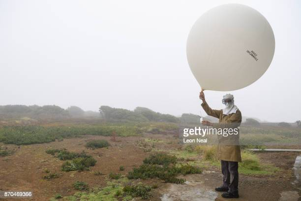 Station Manager Lori Bennett launches the daily weather balloon at the Met Office base near St Helena airport on October 26 2017 in Prosperous Bay...