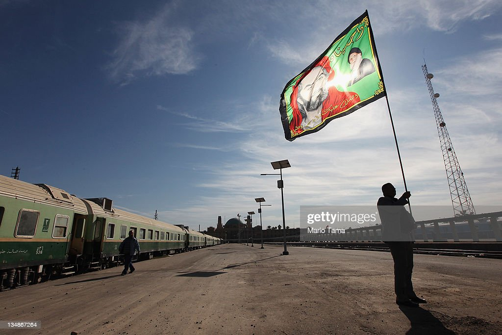 Station master Jawad Khathem prepares to mount a Shi'ite flag on a pole at Baghdad Central Railway Station in preparation for the festival Ashura on December 5, 2011 in Baghdad, Iraq. Iraq's railway system once bustled with trains that connected to destinations including Turkey and London. The Day of Ashura marks the death of Prophet Muhammad's grandson, the revered Husayn ibn Ali at the Battle of Karbala in 61AH and is remembered on the 10th day of Muharram. During the time of Sunni dictator Saddam Hussein's rule Shi'ite festivals were prohibited. Iraq is transitioning nearly nine years after the 2003 U.S. invasion and subsequent occupation. American forces are now in the midst of the final stage of withdrawal from the war-torn country. According to the Iraq Body Count at least 4,485 U.S. military personnel have died in service in Iraq and more than 100,000 Iraqi civilians have died from war-related violence.