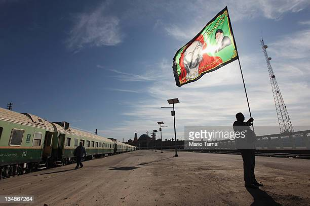 Station master Jawad Khathem prepares to mount a Shi'ite flag on a pole at Baghdad Central Railway Station in preparation for the festival Ashura on...