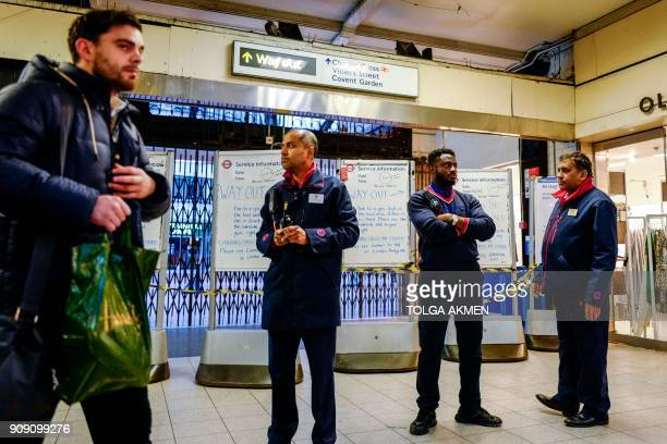 Station staff stand by as notice boards are set up at Embankment tube station advising passengers of a gas leak closing the Strand and Charing Cross...