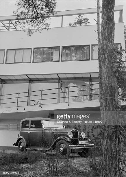 Stationary car in front of a Modernist building Photograph by Zoltan Glass c1930 Stationary car in front of a Modernist building Photograph taken for...