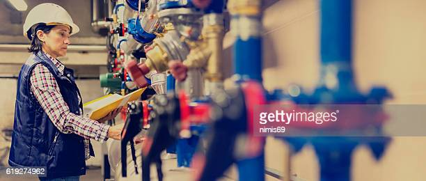 stationary engeneer at work - water pump stock pictures, royalty-free photos & images