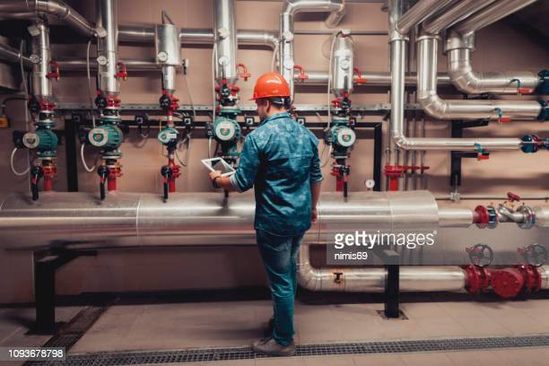 stationary engineer at work - industry stock pictures, royalty-free photos & images