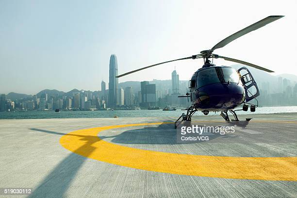 A stationary helicopter in a coastal city